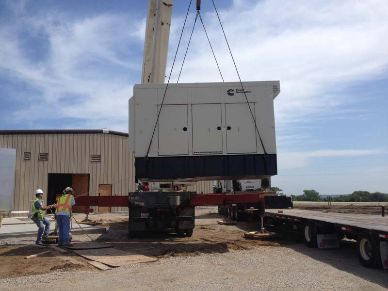 Generator lifted on crane