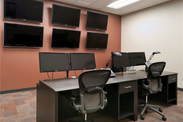 workstations with additional video display on wall